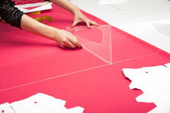 Tailor hands working with pink fabric Royalty Free Stock Photography