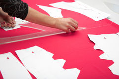 Tailor hands working with pink fabric Stock Photo