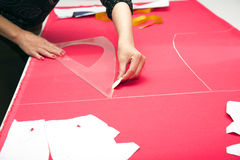 Tailor hands working with pink fabric Stock Photos
