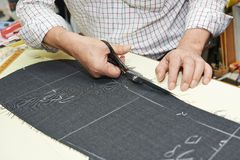 Tailor hands at works Royalty Free Stock Images