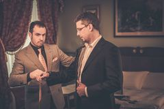 Tailor and his client Royalty Free Stock Photography