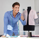 Tailor holding thumbs up Royalty Free Stock Photos