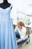 Tailor ironing the fabric. Stock Image