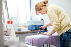 Tailor ironing the fabric. Stock Photography