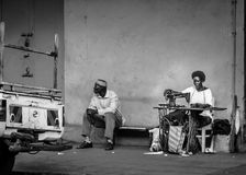 Tailor. Jinja, Uganda - September 2015 - A street tailor at work. The tailors, who are mostly self taught, base on the streets and do all their works by roadside Royalty Free Stock Photography