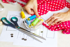 A tailor is laying out a dress/Sewing layout Royalty Free Stock Photography