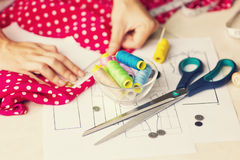 A tailor is laying out a dress/Sewing layout Stock Images