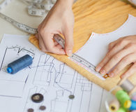 A tailor is laying out a dress/Sewing layout Royalty Free Stock Photo