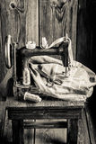 Tailor machine with scissors, cloth and threads. Closeup of Tailor machine with scissors, cloth and threads royalty free stock photo