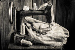 Tailor machine with threads, scissors and cloth Royalty Free Stock Photography