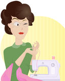 Tailor Made. Experienced woman tailor threading a needle in order to make some nice new clothes Stock Photography