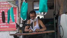 Tailor making cotton masks amid coronavirus pandemic