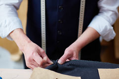 Tailor Making Custom Clothes in Atelier Royalty Free Stock Photo