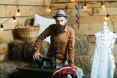 Tailor man near sewing machine Royalty Free Stock Photo