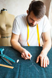 Tailor man working in his tailor shop Royalty Free Stock Photography