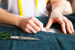 Tailor man working in his tailor shop Stock Photography