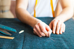 Tailor man working in his tailor shop. Tailoring, close up Stock Photos