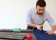 Tailor man working in tailor shop Royalty Free Stock Images