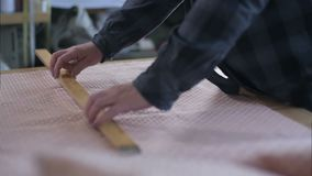 Tailor marking fabric with chalk for cutting. Close up. Slow motion. Professional shot in HD resolution. 109. You can use it e.g. in your commercial video stock footage
