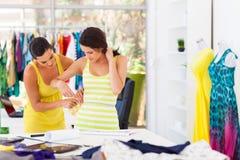 Tailor measuring customer waist Stock Image