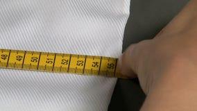 Tailor Measuring Man Shirt Waist Width stock video