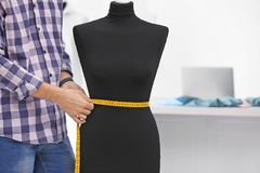 Tailor measuring mannequin in workshop. Closeup Royalty Free Stock Image