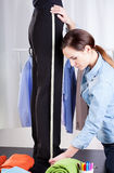 Tailor measuring pant suit Stock Photography