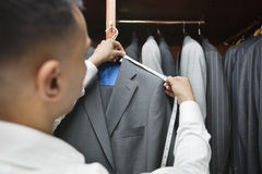 Tailor measuring shoulder of the suit Stock Photos