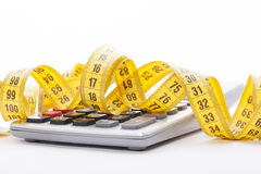 Tailor measuring tape and calculator Royalty Free Stock Photo
