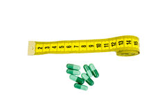 Tailor meter and green herbal pills Stock Photo