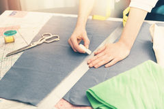 Tailor occupation - marking fabric with chalk. For cutting Royalty Free Stock Photos