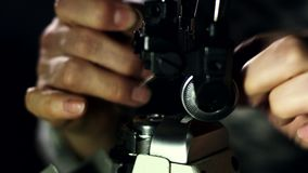 Tailor preparing sewing machine for work. Close up man hands threading a needle stock video