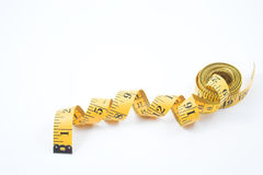 Tailor's measuring tape. A tailor's measuring tape used in the garment / textile industry Royalty Free Stock Images