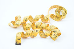 Tailor's measuring tape. A tailor's measuring tape used in the garment / textile industry Royalty Free Stock Photo