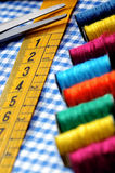 Tailor's measuring tape and scissor Royalty Free Stock Image
