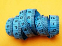 Tailor's metric plastic tape measure Royalty Free Stock Photography