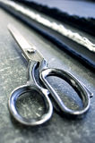 Scissors and fabrics Stock Images