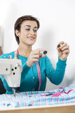 Tailor Selecting Buttons In Sewing Factory Stock Photo