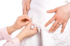 Tailor sew dress of bride Stock Photography