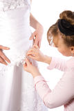 Tailor sew dress of bride Royalty Free Stock Photography
