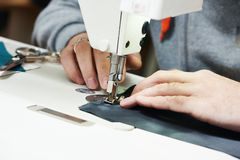 Tailor sewing cloth on mashine Stock Photos