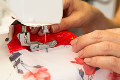Tailor at sewing machine tailoring lingerie or a bra Stock Photos