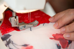 Tailor at sewing machine tailoring lingerie or a bra Stock Photography