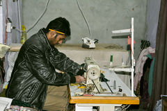 Tailor Sewing. A tailor working in his shop - Old Lahore, Pakistan Royalty Free Stock Photo