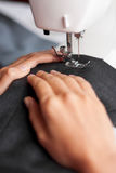 Tailor sews Stock Photos
