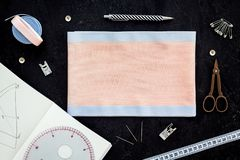 Tailor shop with thread, scissors, fabric. Sewing as hobby. Black background top view mockup royalty free stock images