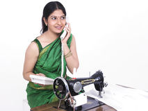 Tailor speaking on her phone Royalty Free Stock Image