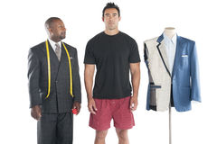 Tailor standing with his customer Stock Image