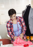 Tailor Stitching Fabric By Mannequin In Factory Stock Photography