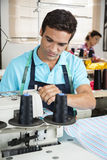 Tailor Stitching At Workbench In Sewing Factory Stock Photography